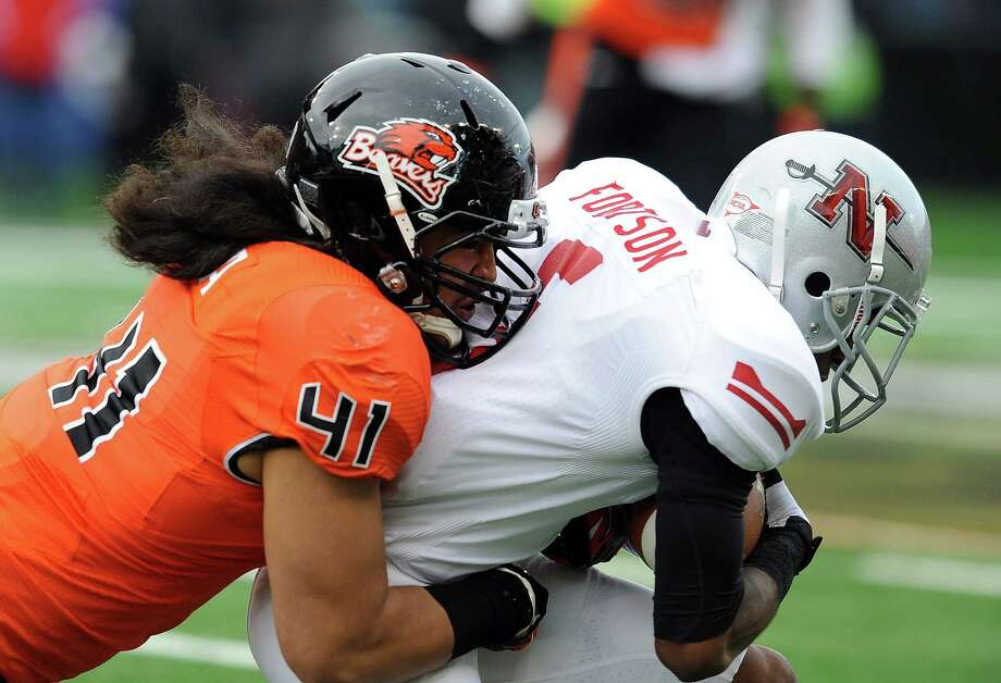 Linebacker Feti Taumoepeau #41 of the Oregon State Beavers tackles wide receiver Carey Fortson #5 of the Nicholls State Colonels in the first quarter of the game on December 1, 2012 at Reser Stadium in Corvallis, Oregon. Photo: Steve Dykes, Getty Images / 2012 Getty Images