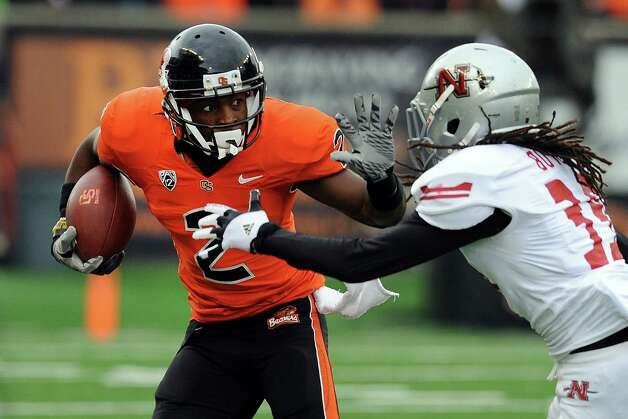 Wide receiver Markus Wheaton #2 of the Oregon State Beavers applies a stiff arm to defensive back Darvin Butler #39 of the Nicholls State Colonels in the second quarter of the game on December 1, 2012 at Reser Stadium in Corvallis, Oregon. Photo: Steve Dykes, Getty Images / 2012 Getty Images