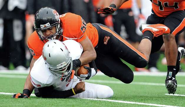 Defensive end Rusty Fernando #56 of the Oregon State Beavers tackles wide receiver LaQuintin Caston #3 of the Nicholls State Colonels in the third quarter of the game on December 1, 2012 at Reser Stadium in Corvallis, Oregon. Oregon State won the game 77-3. Photo: Steve Dykes, Getty Images / 2012 Getty Images