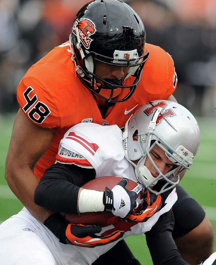 Linebacker Jaswha James #48 of the Oregon State Beavers tackles wide receiver Josh Hanberry #14 of the Nicholls State Colonels in the third quarter of the game on December 1, 2012 at Reser Stadium in Corvallis, Oregon. Oregon State won the game 77-3. Photo: Steve Dykes, Getty Images / 2012 Getty Images