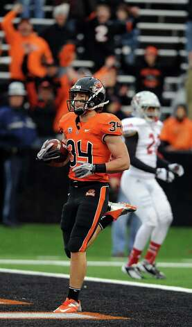 Running back Jordan Jenkins #34 of the Oregon State Beavers scores a touchdown in the fourth quarter of the game against the Nicholls State Colonels on December 1, 2012 at Reser Stadium in Corvallis, Oregon. Oregon State won the game 77-3. Photo: Steve Dykes, Getty Images / 2012 Getty Images