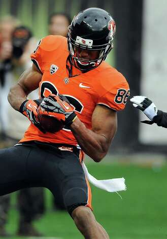 Wide receiver Obum Gwacham #86 of the Oregon State Beavers catches a touchdown pass in fourth quarter of the game against the Nicholls State Colonels on December 1, 2012 at Reser Stadium in Corvallis, Oregon. Oregon State won the game 77-3. Photo: Steve Dykes, Getty Images / 2012 Getty Images