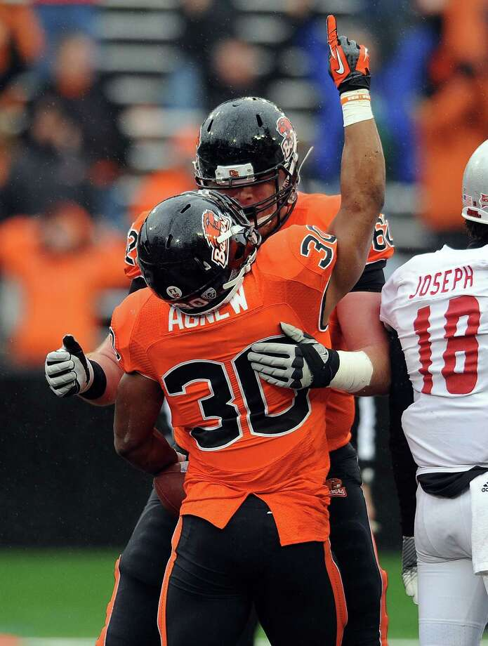 Running back Malcolm Agnew #30 of the Oregon State Beavers celebrates with offensive linesman Gavin Andrews #62 of the Oregon State Beavers after he scored a touchdown in the fourth quarter of the game against the Nicholls State Colonels on December 1, 2012 at Reser Stadium in Corvallis, Oregon. Oregon State won the game 77-3. Photo: Steve Dykes, Getty Images / 2012 Getty Images