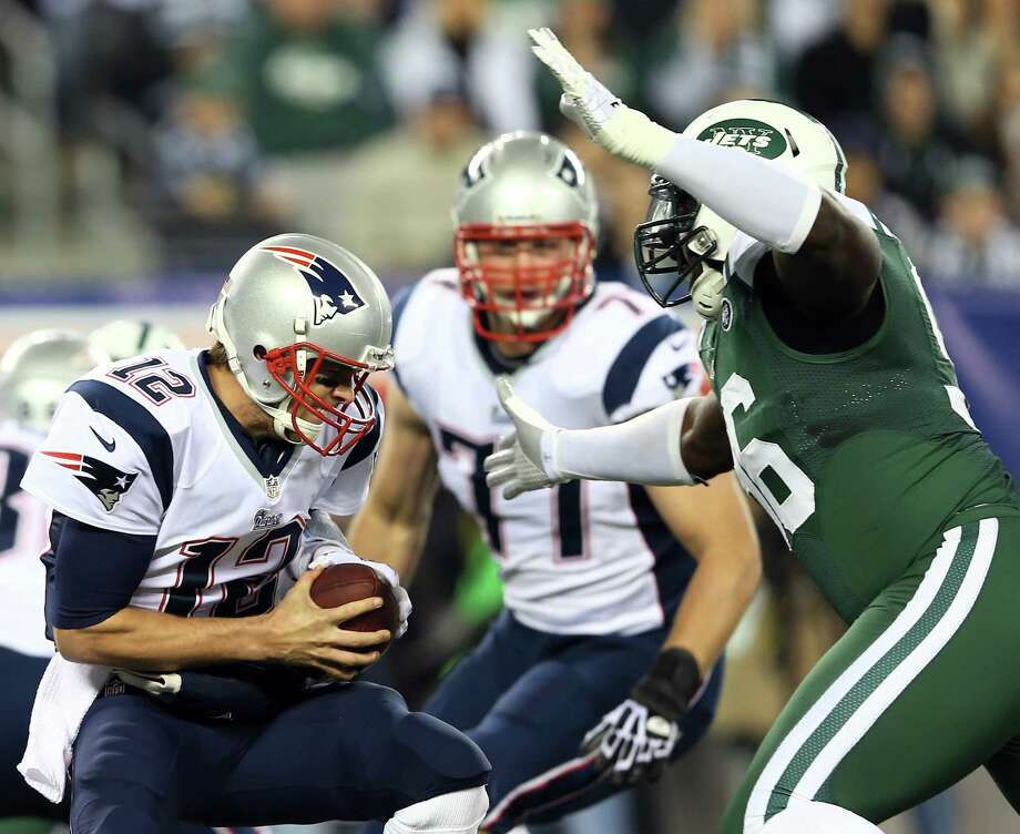 EAST RUTHERFORD, NJ - NOVEMBER 22:  Tom Brady #12 of the New England Patriots braces as he is sacked by Muhammad Wilkerson #96 of the New York Jets on November 22, 2012 at MetLife Stadium in East Rutherford, New Jersey.  (Photo by Elsa/Getty Images) Photo: Elsa, Staff / 2012 Getty Images
