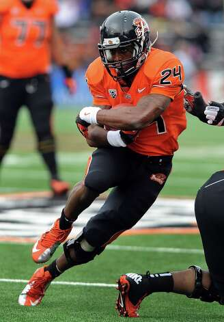 Running back Storm Woods #24 of the Oregon State Beavers runs with the ball in the first quarter of the game against the Nicholls State Colonels on December 1, 2012 at Reser Stadium in Corvallis, Oregon. Photo: Steve Dykes, Getty Images / 2012 Getty Images