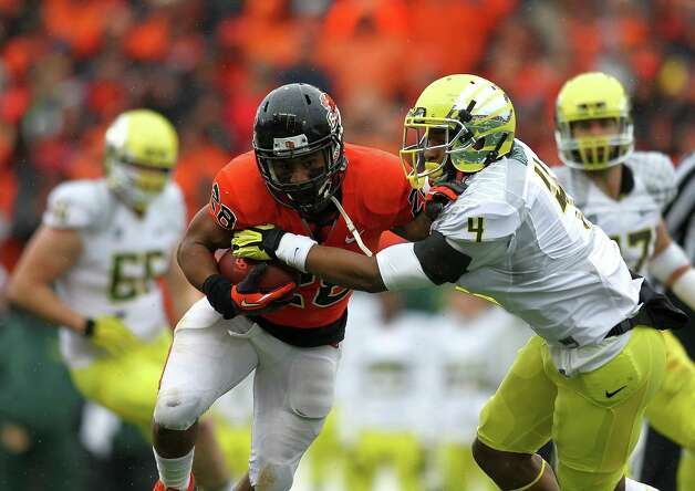 Terron Ward #28 of the Oregon State Beavers runs against Erick Dargan #4 of the Oregon Ducks during the 116th Civil War on November 24, 2012 at the Reser Stadium in Corvallis, Oregon.  (Photo by Jonathan Ferrey/Getty Images) Photo: Jonathan Ferrey, Associated Press / 2012 Getty Images