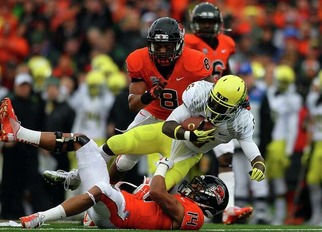 De'Anthony Thomas #6 of the Oregon Ducks is tackled by Jordan Poyer #14 of the Oregon State Beavers during the 116th Civil War on November 24, 2012 at the Reser Stadium in Corvallis, Oregon.  (Photo by Jonathan Ferrey/Getty Images) Photo: Jonathan Ferrey, Associated Press / 2012 Getty Images