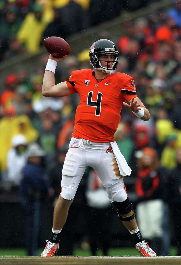 Sean Manion #4 of the Oregon State Beavers throws a pass against the Oregon Ducks during the 116th Civil War on November 24, 2012 at the Reser Stadium in Corvallis, Oregon.  (Photo by Jonathan Ferrey/Getty Images) Photo: Jonathan Ferrey, Associated Press / 2012 Getty Images