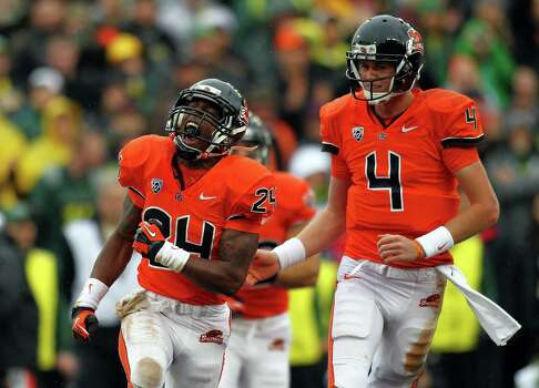 Storm Woods #24 of the Oregon State Beavers celebrates a touchdown run with Sean Manion #4 against the Oregon Ducks during the 116th Civil War on November 24, 2012 at the Reser Stadium in Corvallis, Oregon.  (Photo by Jonathan Ferrey/Getty Images) Photo: Jonathan Ferrey, Associated Press / 2012 Getty Images