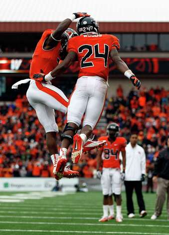 Storm Woods #24 of the Oregon State Beavers celebrates a touchdown run with Brandin Cooks #7 against the Oregon Ducks during the 116th Civil War on November 24, 2012 at the Reser Stadium in Corvallis, Oregon.  (Photo by Jonathan Ferrey/Getty Images) Photo: Jonathan Ferrey, Associated Press / 2012 Getty Images