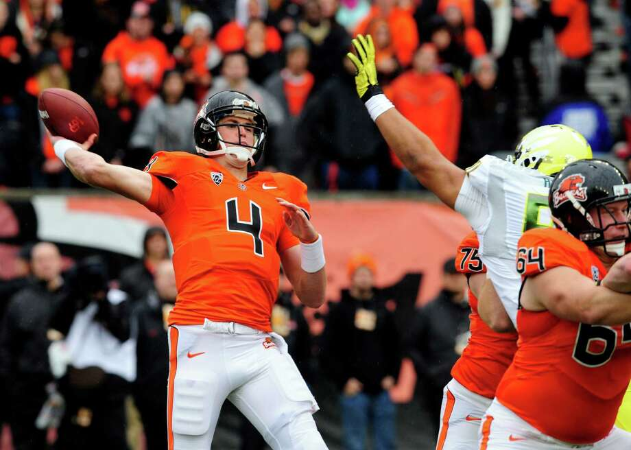 Quarterback Sean Mannion #4 of the Oregon State Beavers throws a pass in the first quarter of the game against the Oregon Ducks on November 24, 2012 at Reser Stadium in Corvallis, Oregon. (Photo by Steve Dykes/Getty Images) Photo: Steve Dykes, Associated Press / 2012 Getty Images