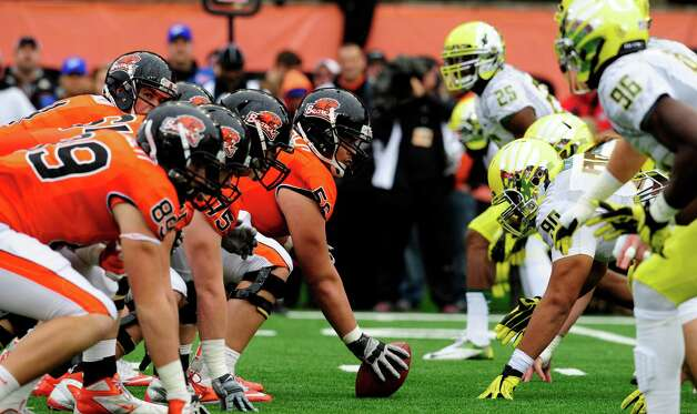 The Oregon State Beavers and the Oregon Ducks line up in the first quarter of the game on November 24, 2012 at Reser Stadium in Corvallis, Oregon. (Photo by Steve Dykes/Getty Images) Photo: Steve Dykes, Associated Press / 2012 Getty Images