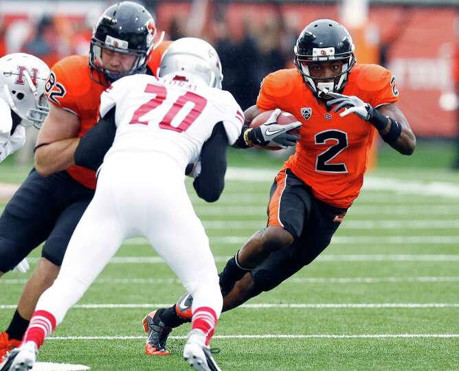Oregon State wide receiver Markus, right, runs as teammate Colby Prince blocks Nicholls State defend