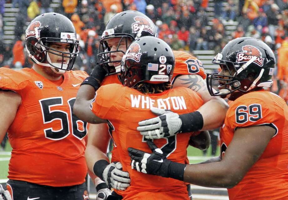 Oregon State wide receiver Markus Wheaton celebrates his touchdown reception with teammates, from left, Michael Morovick, Colin Kelly and Josh Andrews during the first half of an NCAA college football game against Nicholls State in Corvallis, Ore., Saturday, Dec. 1, 2012. (AP Photo/Don Ryan) Photo: Don Ryan, Associated Press / AP
