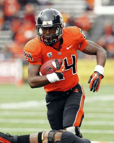 Oregon State running back Storm Woods gains yardage during the first half of an NCAA college football game against Nicholls State in Corvallis, Ore., Saturday, Dec. 1, 2012. (AP Photo/Don Ryan) Photo: Don Ryan, Associated Press / AP