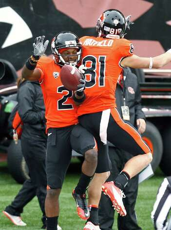 Oregon State wide receiver Markus Wheaton, left, celebrates his touchdown with teammate Micah Hatfield during the first half of an NCAA college football game against Nicholls State in Corvallis, Ore., Saturday, Dec. 1, 2012. (AP Photo/Don Ryan) Photo: Don Ryan, Associated Press / AP