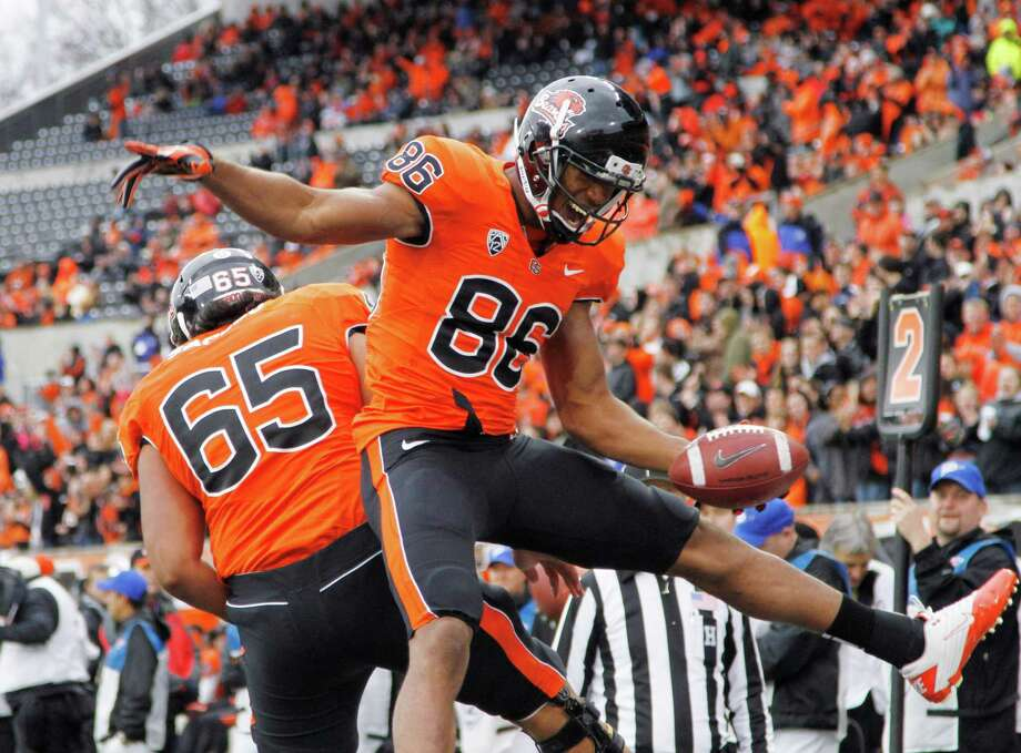 Oregon State wide receiver Obum Gwachum, right, celebrates his touchdown with teammate Roman Sapolu during the second half of an NCAA college football game in Corvallis, Ore., Saturday, Dec. 1, 2012.  Oregon State defeated Nicholls State 77-3. (AP Photo/Don Ryan) Photo: Don Ryan, Associated Press / AP