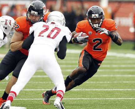 Oregon State wide receiver Markus Wheaton, right, runs as teammate Colby Prince, left, blocks Nicholls State defender Dwight Storay during the first half of their NCAA college football game in Corvallis, Ore., Saturday, Dec. 1, 2012.(AP Photo/Don Ryan) Photo: Don Ryan, Associated Press / AP