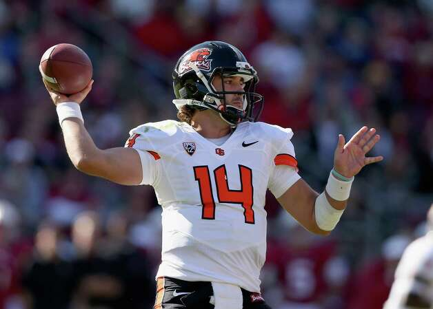 Cody Vaz #14 of the Oregon State Beavers passes the ball during their game against the Stanford Cardinal at Stanford Stadium on November 10, 2012 in Stanford, California. Photo: Ezra Shaw, Getty Images / 2012 Getty Images