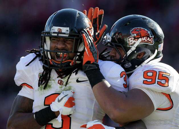 Oregon State safety Anthony Watkins (3) celebrates after sacking Stanford quarterback Kevin Hogan with defensive end Scott Crichton (95) during the third quarter of an NCAA college football game in Stanford, Calif., Saturday, Nov. 10, 2012. Stanford won 27-23. (AP Photo/Jeff Chiu) Photo: Jeff Chiu, Associated Press / AP