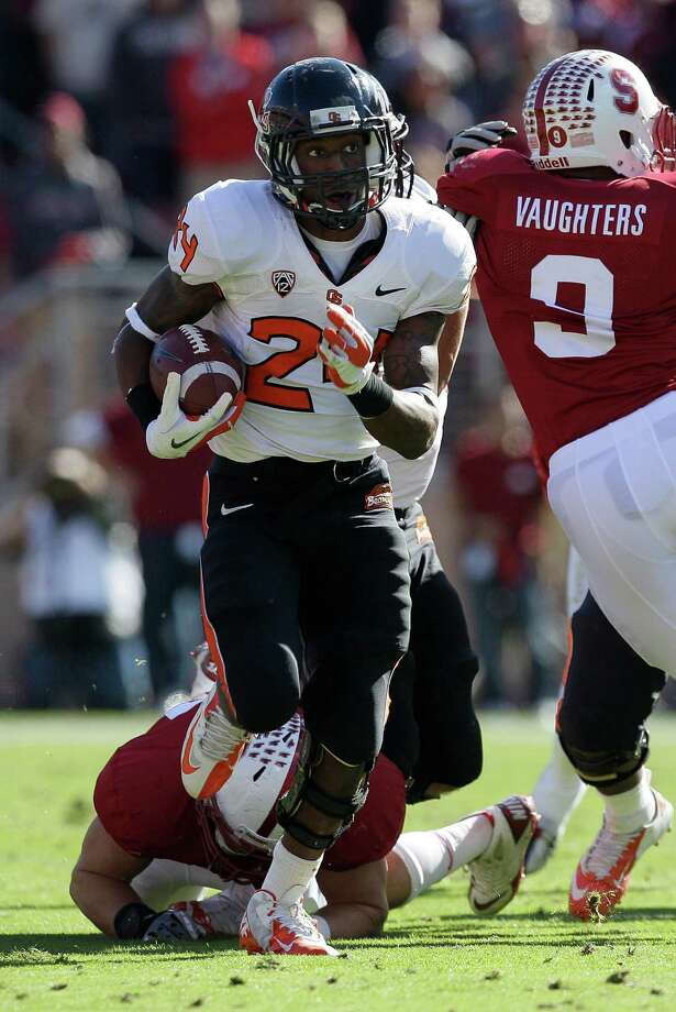 Oregon State running back Storm Woods (24) against Stanford during the first half  of an NCAA college football game in Stanford, Calif., Saturday, Nov. 10, 2012. (AP Photo/Jeff Chiu) Photo: Jeff Chiu, Associated Press / AP