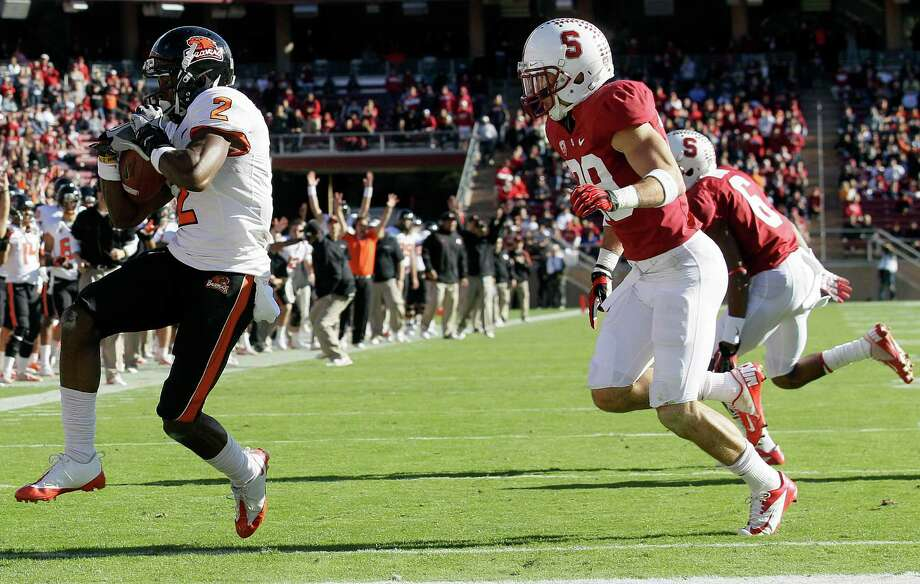 Oregon State wide receiver Markus Wheaton (2) scores on a 23-yard touchdown pass in front of Stanford safety Ed Reynolds (29) during the third quarter of an NCAA college football game in Stanford, Calif., Saturday, Nov. 10, 2012. (AP Photo/Jeff Chiu) Photo: Jeff Chiu, Associated Press / AP