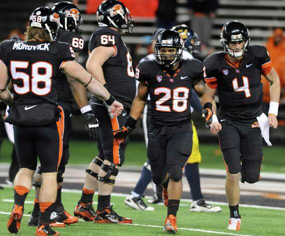 Oregon State Terron Ward (28) is congratulated by teammates for a touchdown run against California during the second half of an NCAA college football game in Corvallis, Ore., Saturday Nov.,17, 2012. Oregon State beat California 62-14. (AP Photo/Greg Wahl-Stephens) Photo: Greg Wahl-Stephens, Associated Press / FR29287 AP