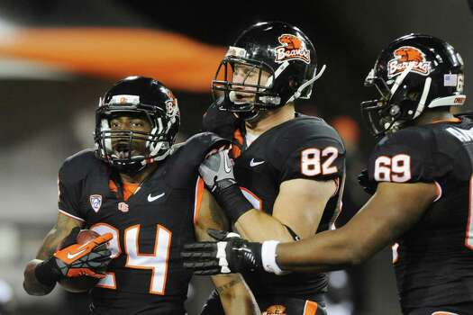 Oregon State's Storm Woods (24) celebrates a run against California with Colby Prince (82) during the first half of an NCAA college football game in Corvallis, Ore., Saturday Nov.,17, 2012. (AP Photo/Greg Wahl-Stephens) Photo: Greg Wahl-Stephens, Associated Press / FR29287 AP