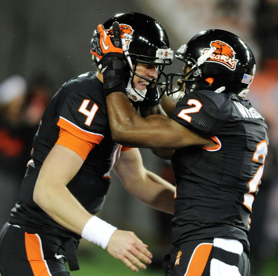 Oregon State's Markus Wheaton (2) celebrates a touchdown against California with quarterback Sean Mannion (4) during the first half of an NCAA college football game in Corvallis, Ore., Saturday Nov.,17, 2012. (AP Photo/Greg Wahl-Stephens) Photo: Greg Wahl-Stephens, Associated Press / FR29287 AP