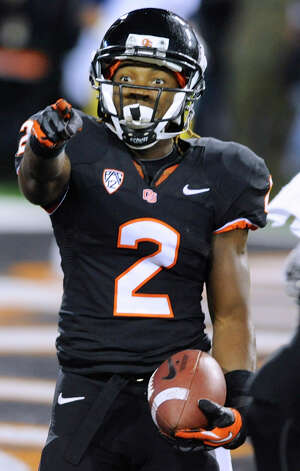 Oregon State's Markus Wheaton (2) celebrates a touchdown against California during the first half of an NCAA college football game in Corvallis, Ore., Saturday Nov.,17, 2012. (AP Photo/Greg Wahl-Stephens) Photo: Greg Wahl-Stephens, Associated Press / FR29287 AP