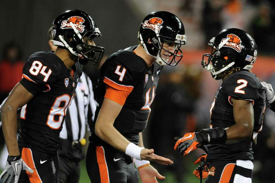 Oregon State's Markus Wheaton (2) celebrates a touchdown against California with quarterback Sean Mannion (4) and Kevin Cummings (84) during the first half of an NCAA college football game in Corvallis, Ore., Saturday Nov.,17, 2012. (AP Photo/Greg Wahl-Stephens) Photo: Greg Wahl-Stephens, Associated Press / FR29287 AP