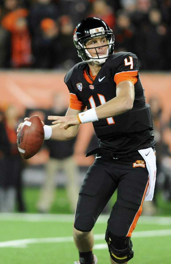 Oregon State quarterback Sean Mannion (4) prepares to throw against California during the first half of an NCAA college football game in Corvallis, Ore., Saturday Nov.,17, 2012. (AP Photo/Greg Wahl-Stephens) Photo: Greg Wahl-Stephens, Associated Press / FR29287 AP