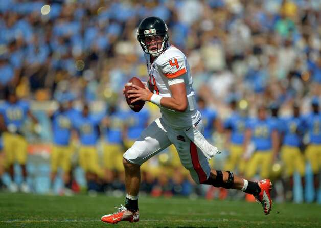 Oregon State quarterback Sean Mannion gets set to pass during the second half of their NCAA college football game against UCLA, Saturday, Sept. 22, 2012, in Pasadena, Calif. Oregon State won 27-20. (AP Photo/Mark J. Terrill) Photo: Mark J. Terrill, Associated Press / AP
