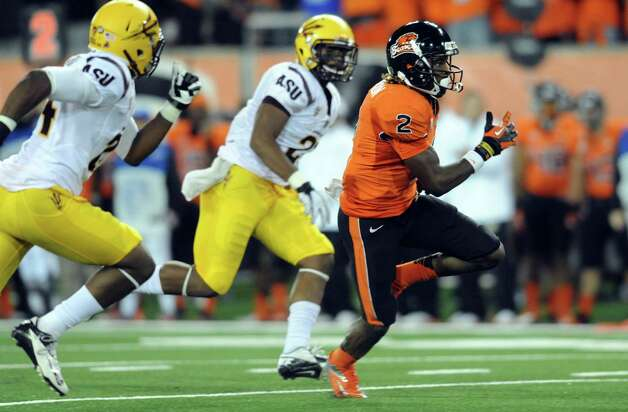 Wide receiver Markus Wheaton #2 of the Oregon State Beavers runs for a 50 yard touchdown as cornerback Osahon Irabor #24 and linebacker Steffon Martin #2 of the Arizona State Sun Devils give chase in the first quarter of the game on November 3, 2012 at Reser Stadium in Corvallis, Oregon. Photo: Steve Dykes, Getty Images / 2012 Getty Images