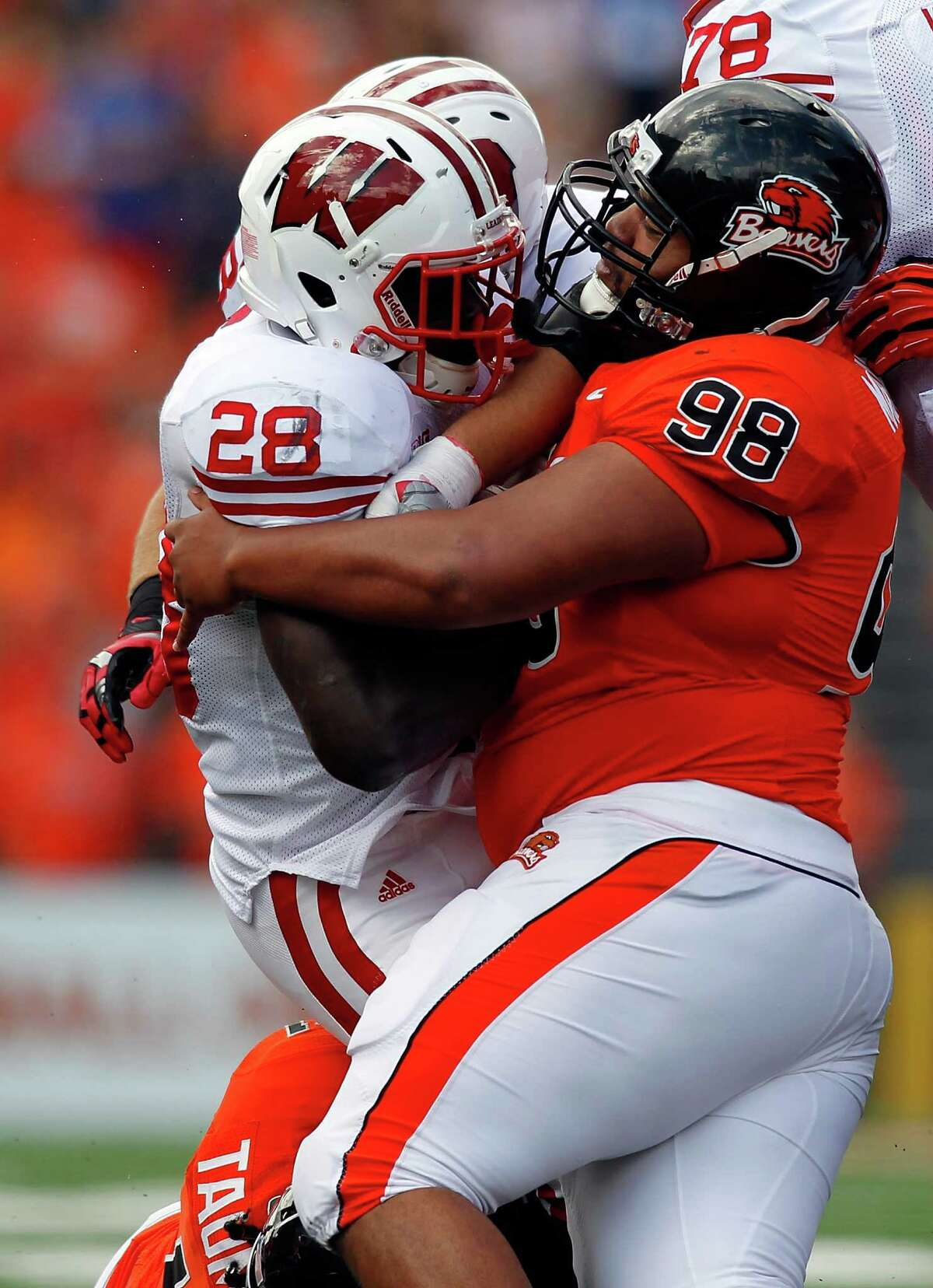 Montee Ball #28 of the Wisconsin Badgers is stopped by Castro Masaniai #98of the Oregon State Beavers on September 8, 2012 at the Reser Stadium in Corvallis, Oregon.