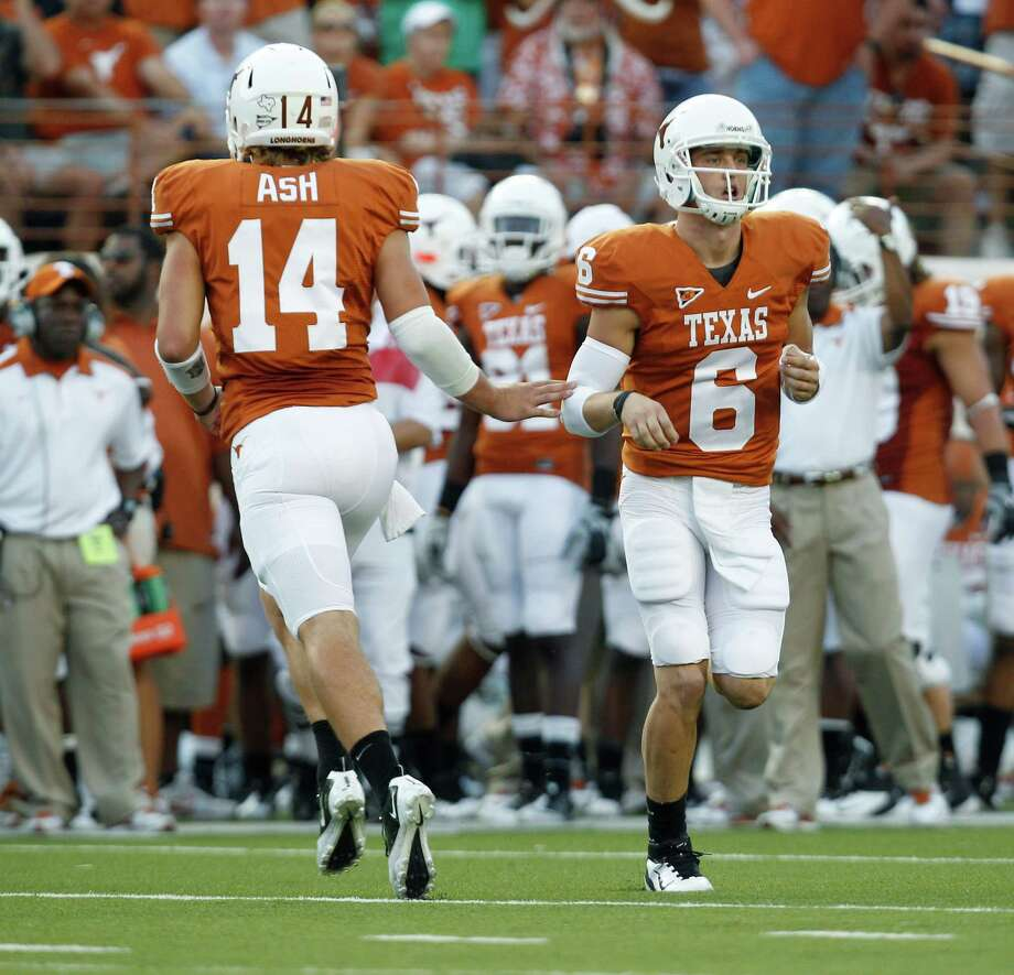 Texas quarterbacks David Ash (14) and Case McCoy (6) are used to having to be ready at all times. Photo: Eric Gay, STF / AP