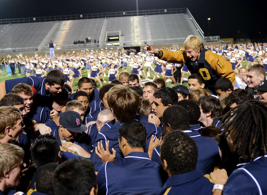 O'Connor football players celebrate on the field during a NISD three school football playoff pep rally for Brandeis, Brennan and O'Connor at Farris Stadium in San Antonio, Thursday, December 6, 2012.