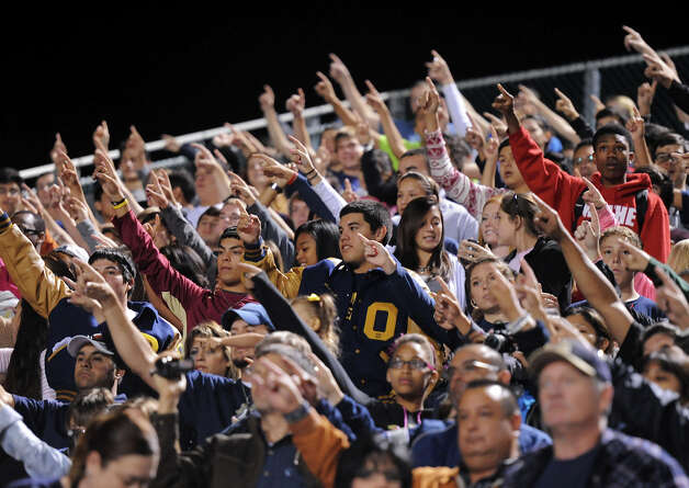 O'Connor fans stand for their Alma Mater during a NISD three school football playoff pep rally for Brandeis, Brennan and O'Connor at Farris Stadium in San Antonio, Thursday, December 6, 2012.