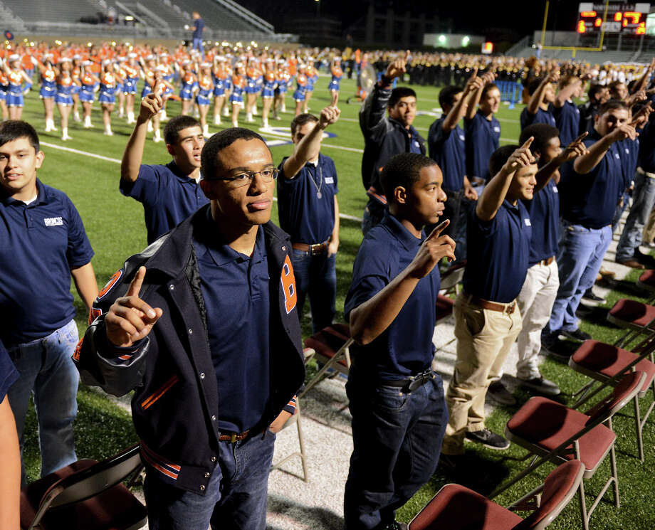Brandeis varsity football players stand for their Alma Mater during a NISD three school football playoff pep rally for Brandeis, Brennan and O'Connor at Farris Stadium in San Antonio, Thursday, December 6, 2012.