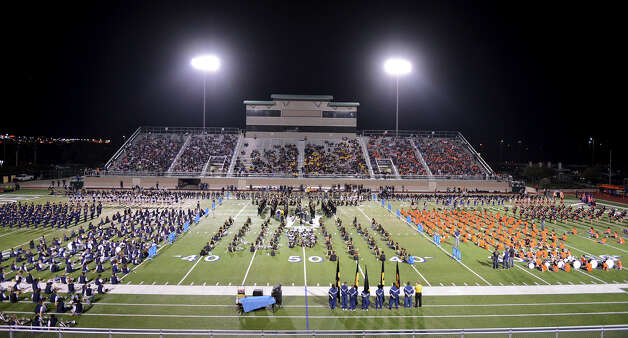 Band, spirit squads and football players gather on the field during a NISD three school football playoff pep rally for Brandeis, Brennan and O'Connor at Farris Stadium in San Antonio, Thursday, December 6, 2012.