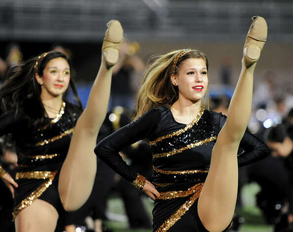 Brennan dance team members preform during a NISD three school football playoff pep rally for Brandeis, Brennan and O'Connor at Farris Stadium in San Antonio, Thursday, December 6, 2012.