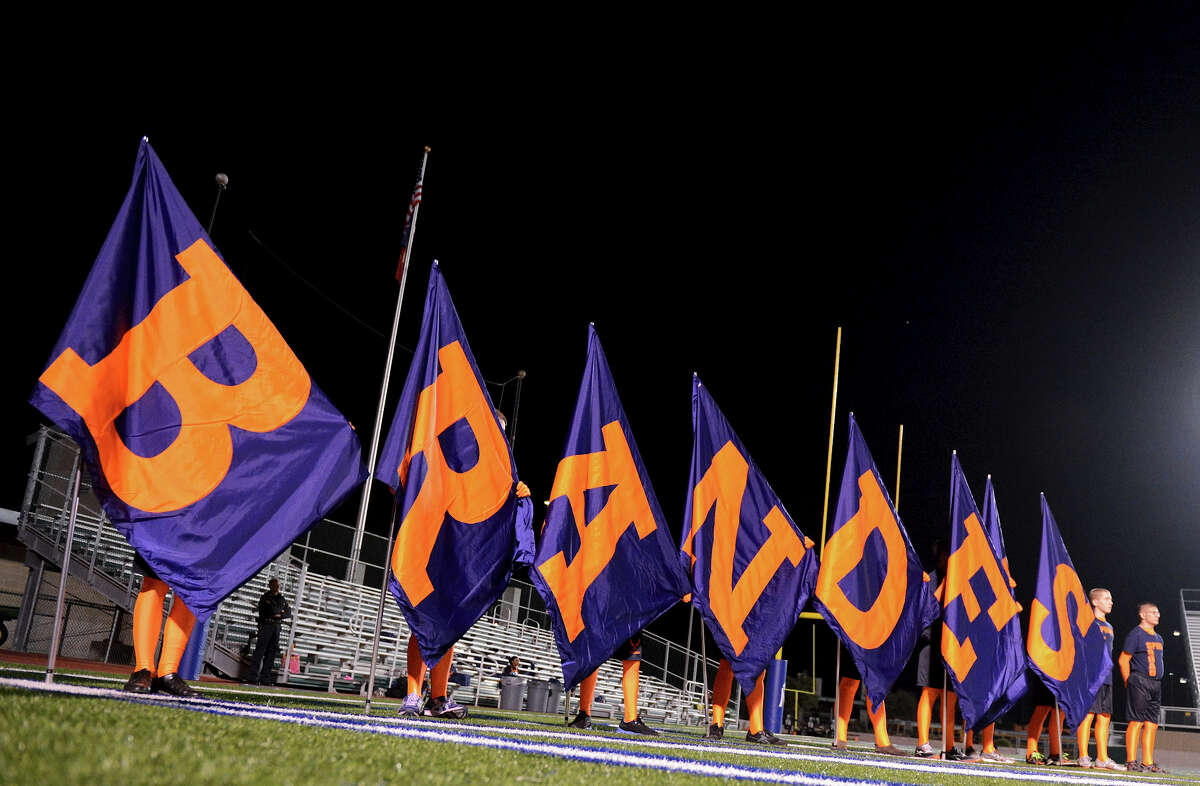 Brandeis spirit members hold flags during a NISD three school football playoff pep rally for Brandeis, Brennan and O'Connor at Farris Stadium in San Antonio, Thursday, December 6, 2012. John Albright / Special to the Express-News.