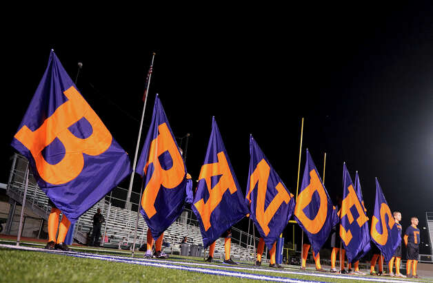 Brandeis spirit members hold flags during a NISD three school football playoff pep rally for Brandeis, Brennan and O'Connor at Farris Stadium in San Antonio, Thursday, December 6, 2012.