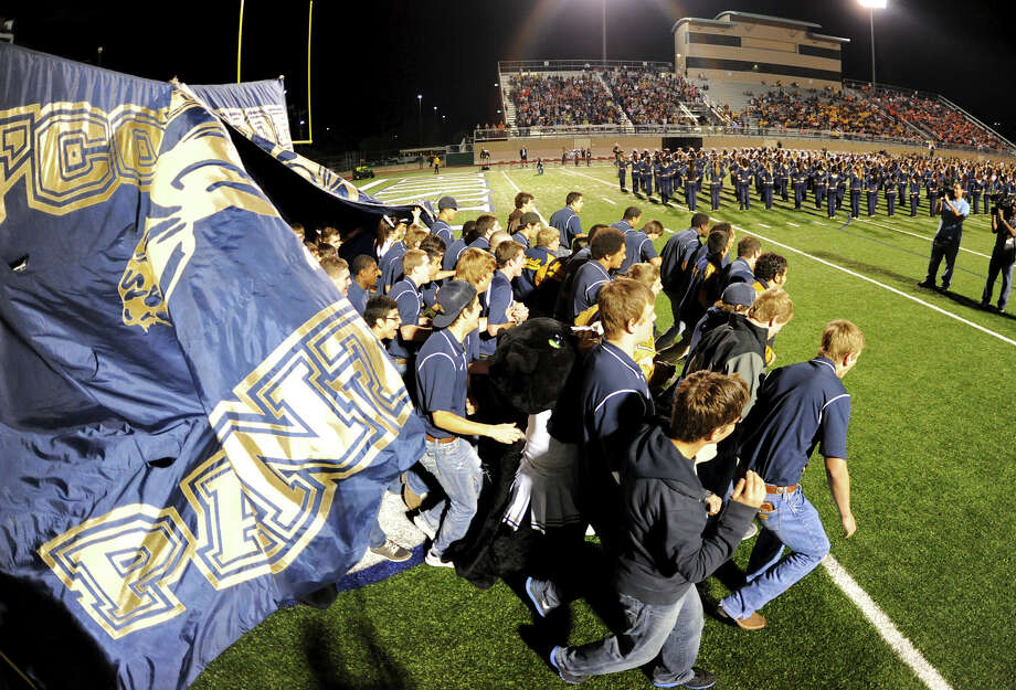 The O'Connor varsity football team walks onto the field during a NISD three school football playoff pep rally for Brandeis, Brennan and O'Connor at Farris Stadium in San Antonio, Thursday, December 6, 2012.