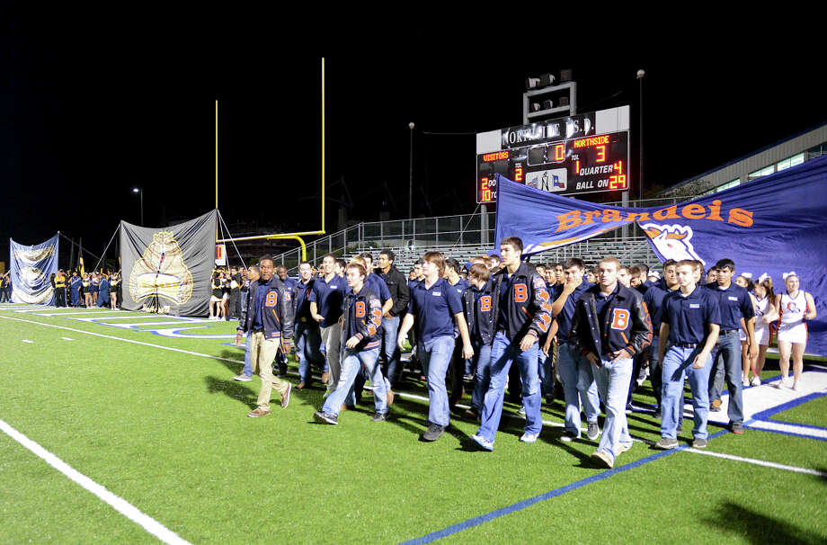 The Brandeis varsity football teams walks onto the field during a NISD three school football playoff pep rally for Brandeis, Brennan and O'Connor at Farris Stadium in San Antonio, Thursday, December 6, 2012.