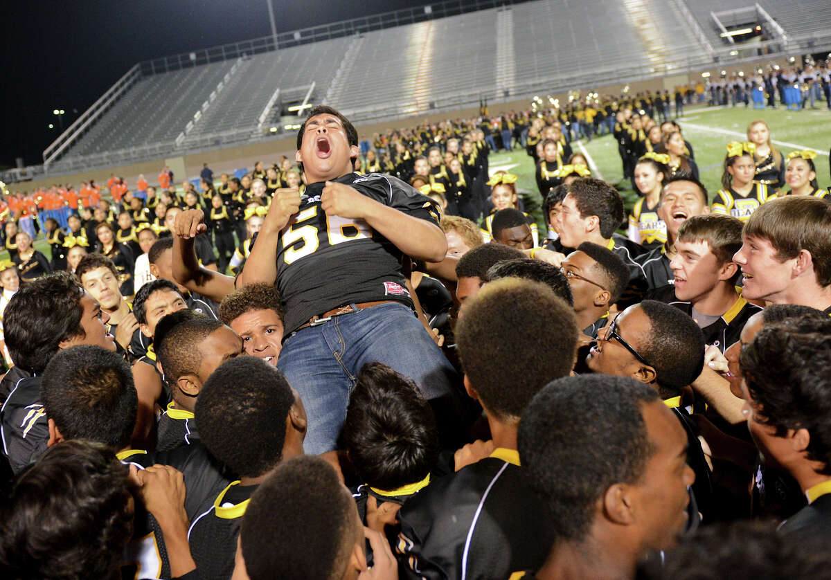 Brennan's Julio Compean is lifted up by his teammates as the Bears celebrate on the field at the end of a NISD three school football playoff pep rally for Brandeis, Brennan and O'Connor at Farris Stadium in San Antonio, Thursday, December 6, 2012. John Albright / Special to the Express-News.