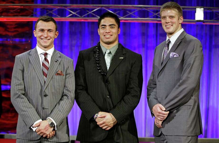From left, Heisman Trophy candidates Texas A&M's Johnny Manziel, Notre Dame's Manti Te'o and Kansas State's Collin Klein pose for a photo at the Home Depot College Football Awards in Lake Buena Vista, Fla., Thursday, Dec. 6, 2012. (AP Photo/John Raoux) Photo: John Raoux, Associated Press / AP