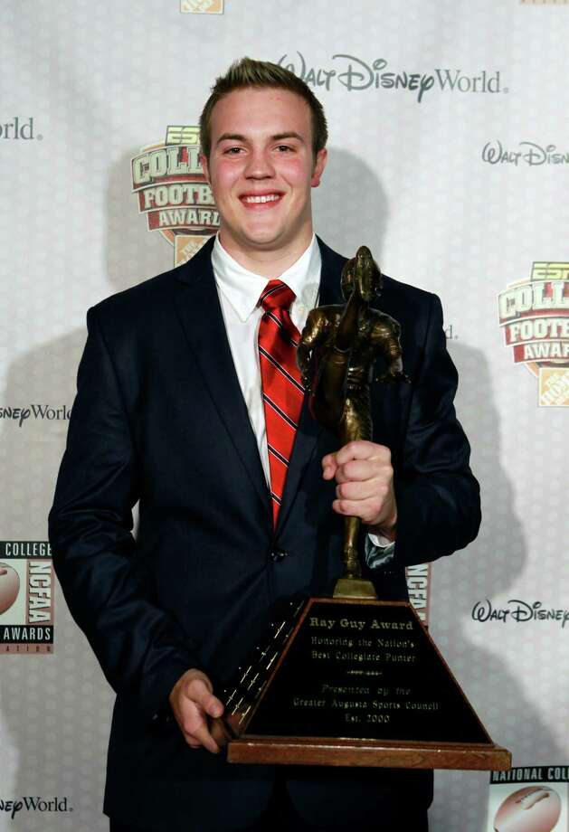 Louisiana Tech's Ryan Allen displays his Ray Guy Award after being named the nation's outstanding punter at the Home Depot College Football Awards in Lake Buena Vista, Fla., Thursday, Dec. 6, 2012. (AP Photo/John Raoux) Photo: John Raoux, Associated Press / AP