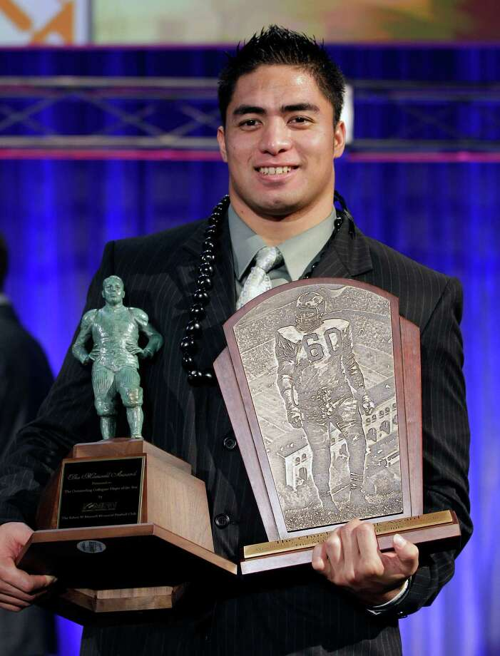 Notre Dame defensive back Manti Te'o  displays his trophyies after being named the college defensive player of the year and the nation's college player of the year at the Home Depot College Football Awards in Lake Buena Vista, Fla., Thursday, Dec. 6, 2012. (AP Photo/John Raoux) Photo: John Raoux, Associated Press / AP