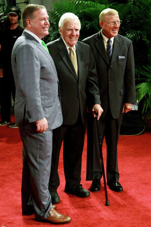 Notre Dame head coach Brian Kelly, left, stands for a photo with former Notre Dame coaches Ara Parseghian, center, and Lou Holtz, right, before the Home Depot College Football Awards in Lake Buena Vista, Fla., Thursday, Dec. 6, 2012. (AP Photo/John Raoux) Photo: John Raoux, Associated Press / AP